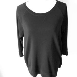 Dressy sweat shirt with 3/4 length sleeves.